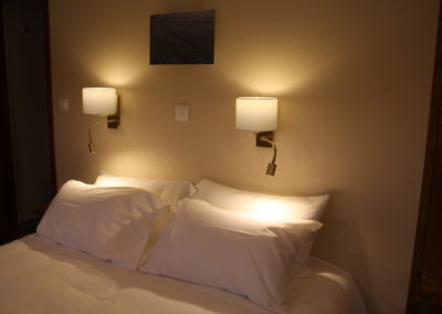 Luxe beds with reading lamps